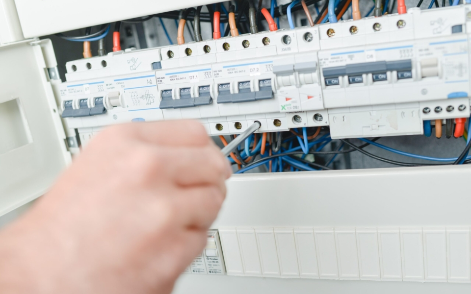 Electrician repairing a fuse